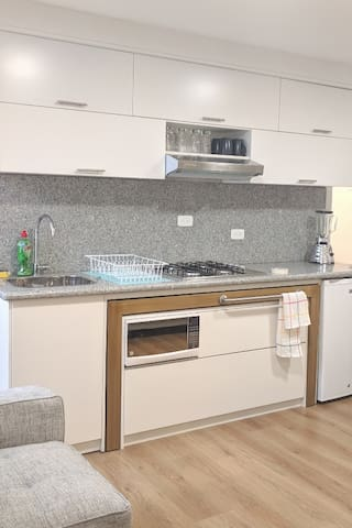 Our well equiped kitchen has everything you need. Even an extra table or counter comes off from the lower cabinet as you can see it in light brown(you may pull it carefully).