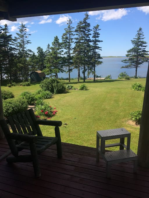 Large screened in deck with a BBQ and overlooking lovely waterfront location.
