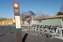 City bike rentals at the entrance to walking trails. one block from our unit.
