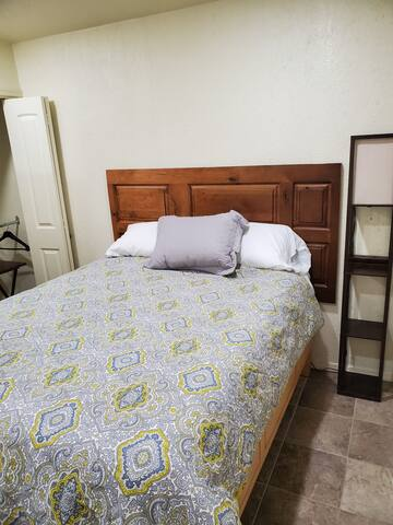 Comfortable  queen size bed with phone charging  nightstand