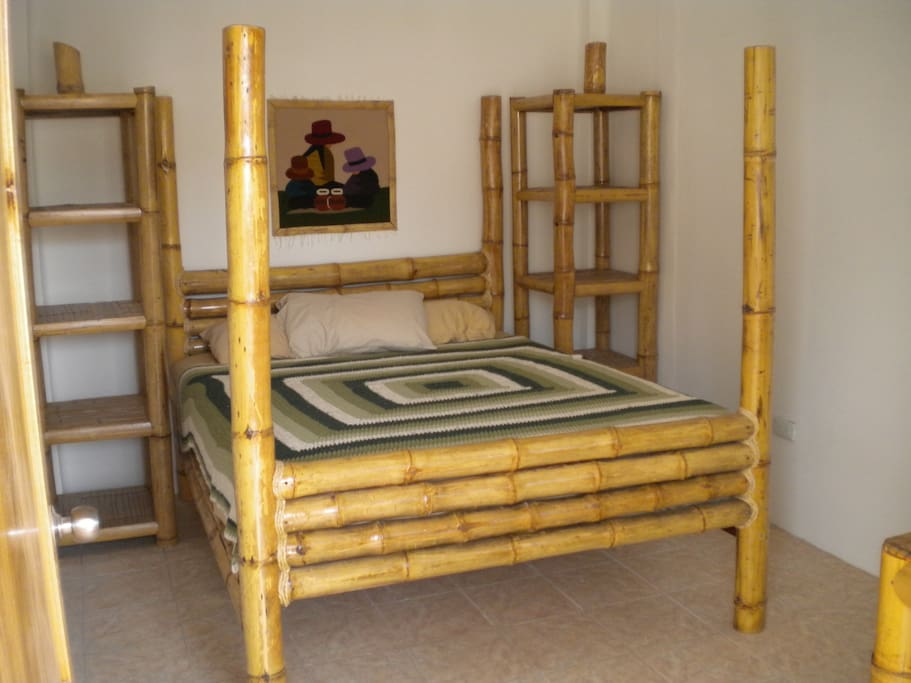 Handmade bamboo furniture with 1500 thread count sheets.