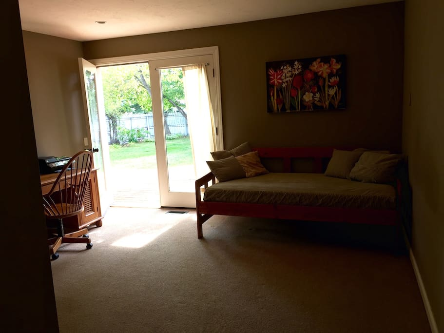 Private entrance and deck off of master suite with day bed and desk. Queen bed in separate area