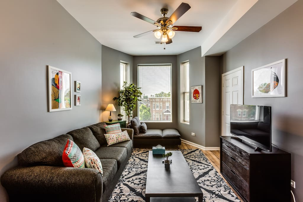 Our front living room has a bay window and plenty of space to curl up and watch Netflix!