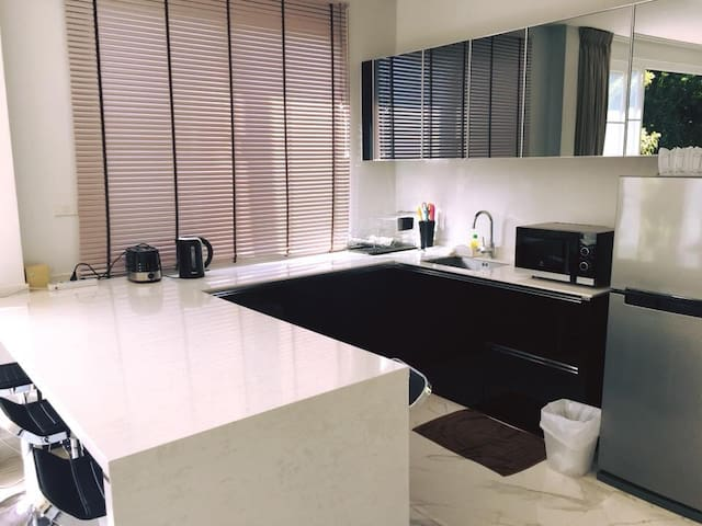 Our kitchen is equipped with microwave , toaster, kettle and refrigerator.