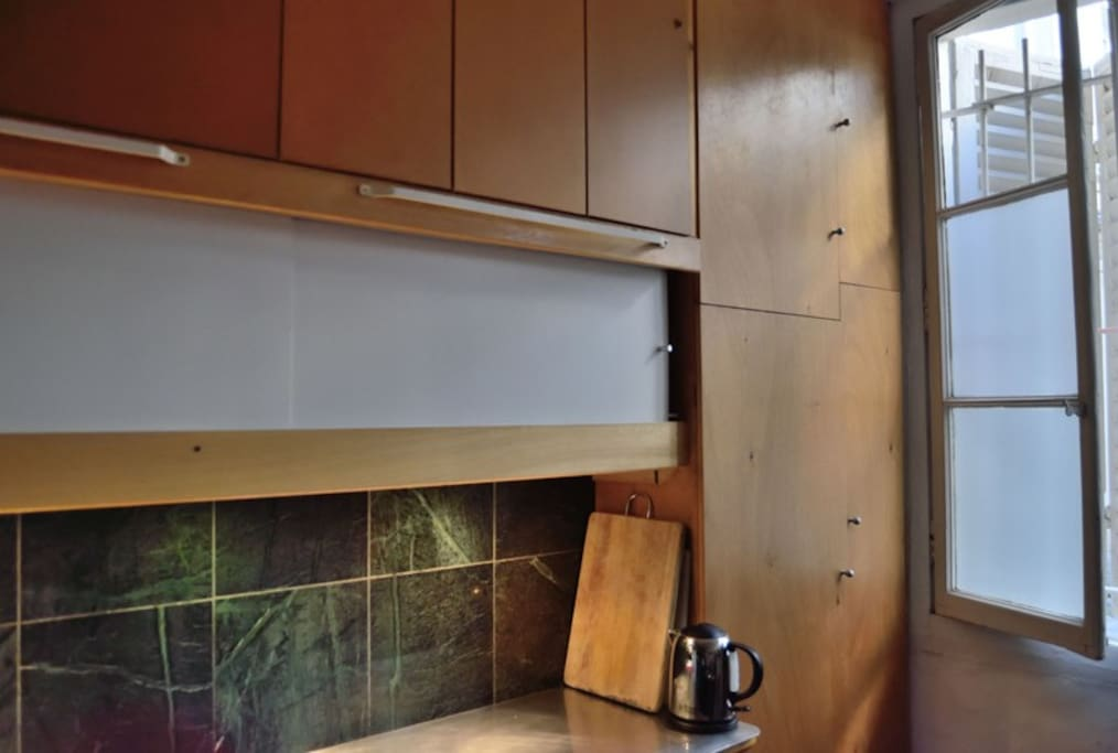 kitchenette with designer kettle and the traditional warped Parisian window