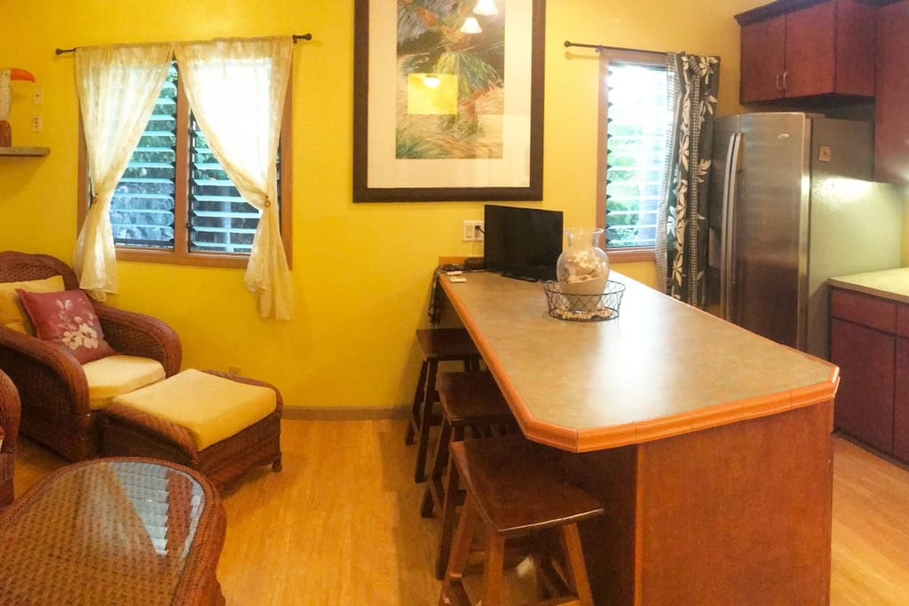 Pano view of sitting area and kitchenette.