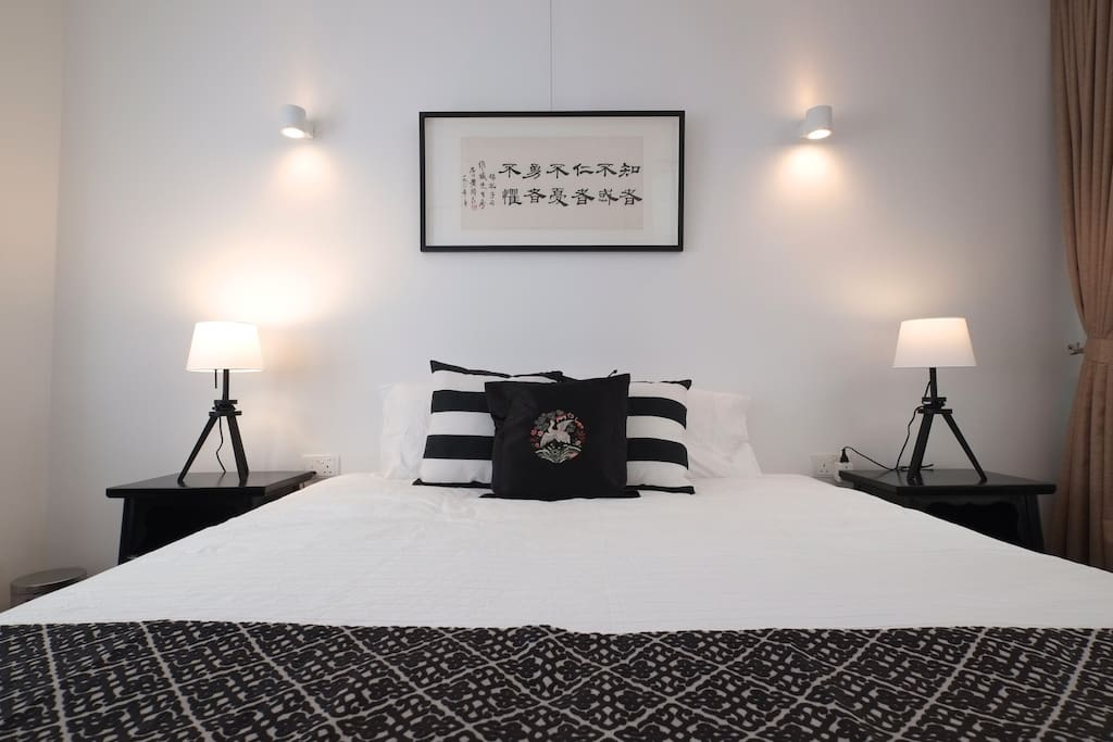 Black and white décor gives the room a modern chic in a historic setting.