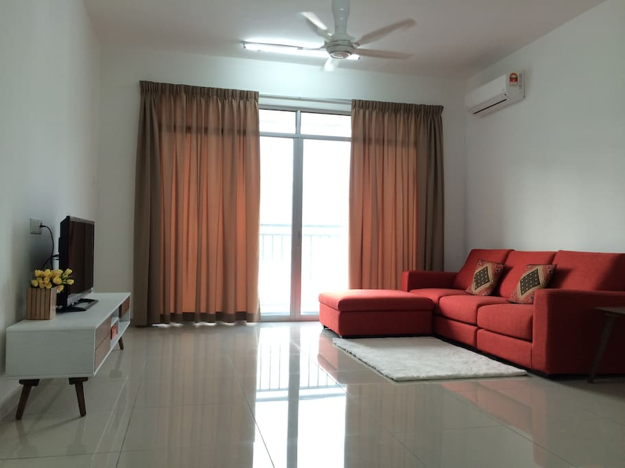 Spacious living area with TV, DVD player, aircon and carpet