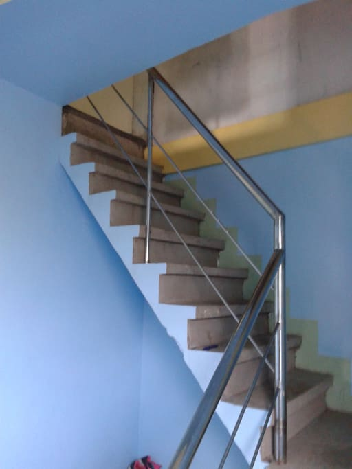 Staircase leading to guest room.