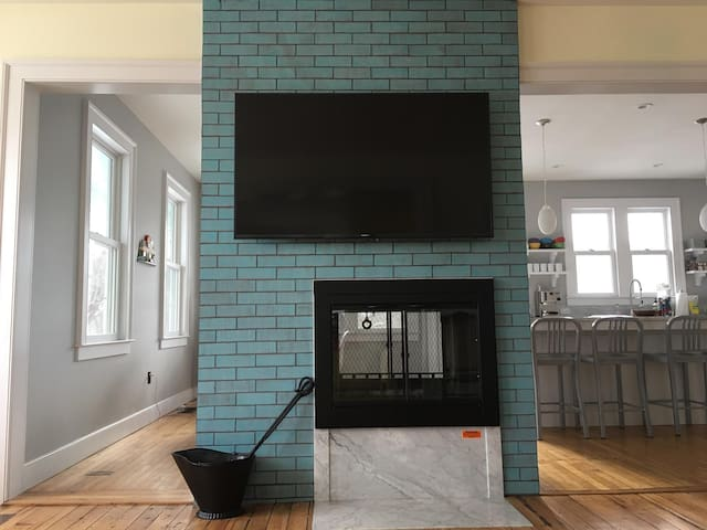 Brand NEW 60 Inch HD 4K Smart TV above the Fireplace