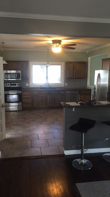 Very spacious kitchen with new stainless steel Samsung appliances (oven/stove, microwave, refrigerator/freezer) and a lovely bar that serves as a great workshop for the traveler needing his/her laptop access!