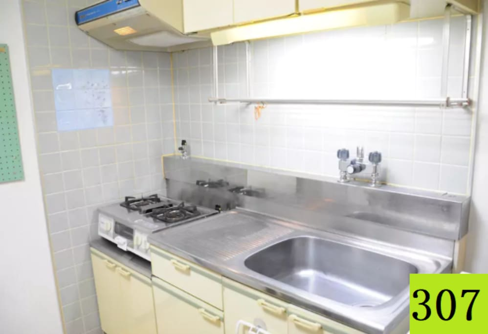 Kitchen with refrigerator, Micro oven and basic utensils