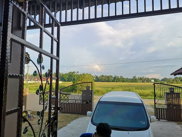 ENTRANCE WITH VIEW OF PADDY FIELD
