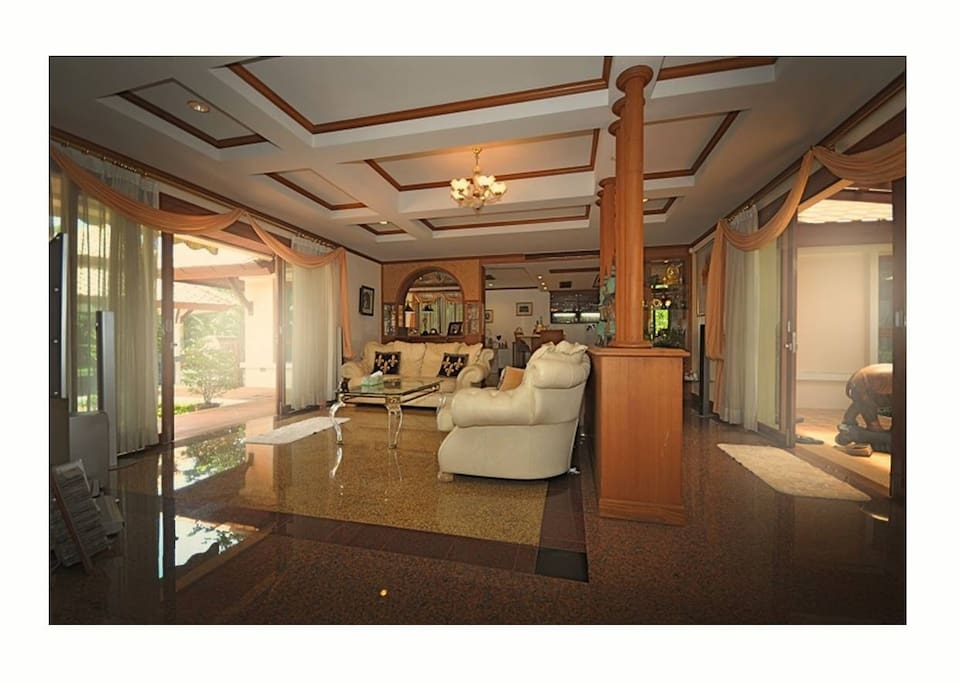 Cozy living room overlooking the pool and the golf course. Great way to relax and enjoy your coffee.