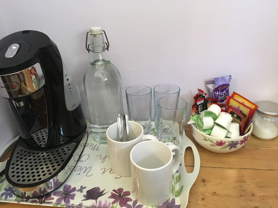 A selection of tea, coffee, milk and sugar and water to be found in your room.