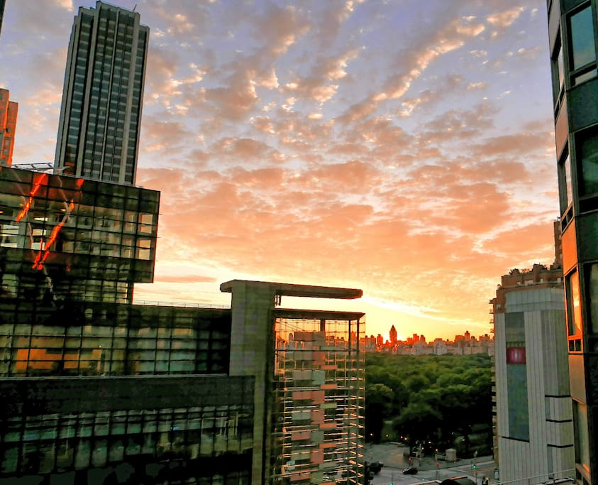 Sunrise view from our apartment overlooking Columbus Circle and Central Park!