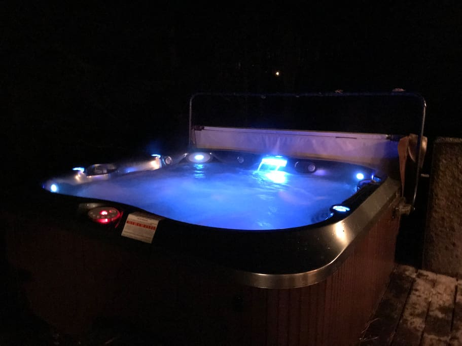 Our large Hot Tub lit up at night