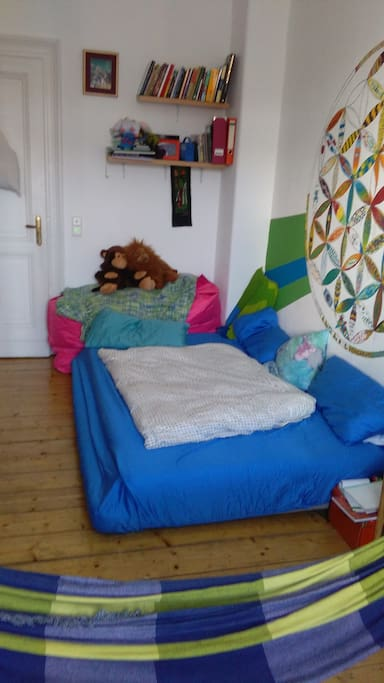 Cozy Bed and colorful walls