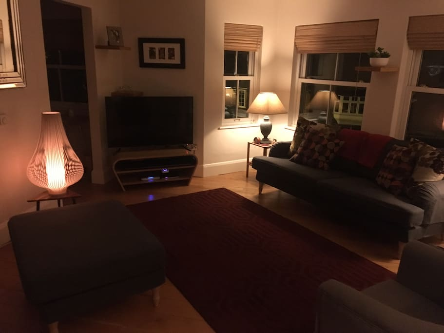 Living room is cosy in the evening.