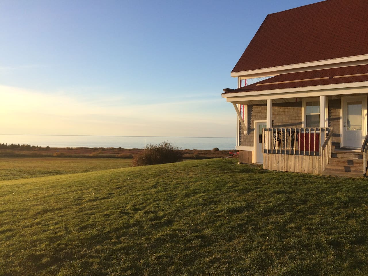 The million dollar view! The Northumberland strait is in the background.  You can walk on the shore a mile in either direction.  The home is over 700 feet from the road, on a ten acre farm. Beach, while enjoying safe privacy for children and pets.