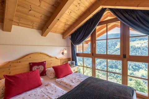 """Moderno """"Appartamento Malga"""" con Vista Montagna, Wi-Fi, Giardino e Terrazza; Parcheggio disponibile"""