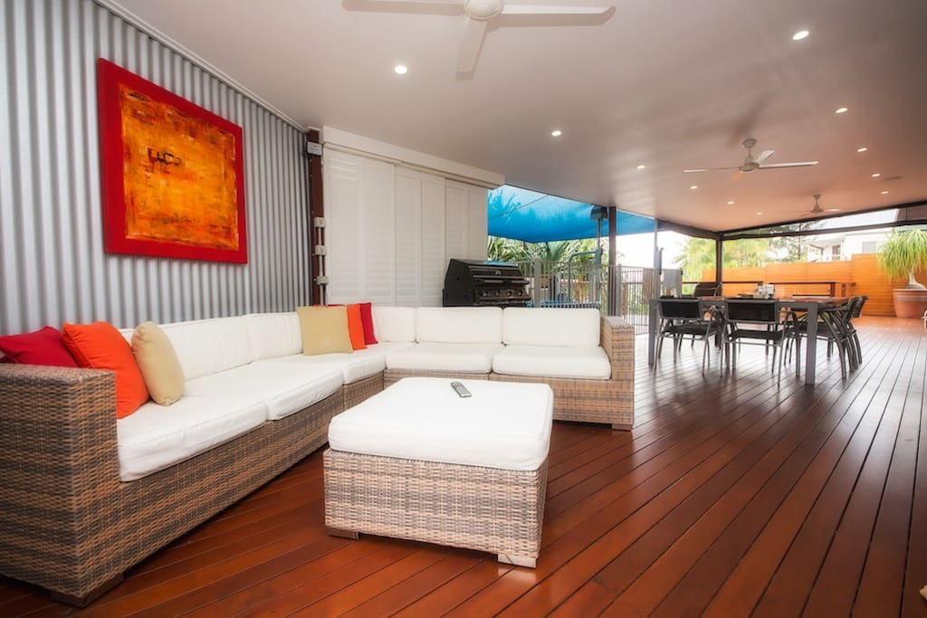 Beautiful water front outdoor deck with BBQ, lounge, spa, TV and dining setting
