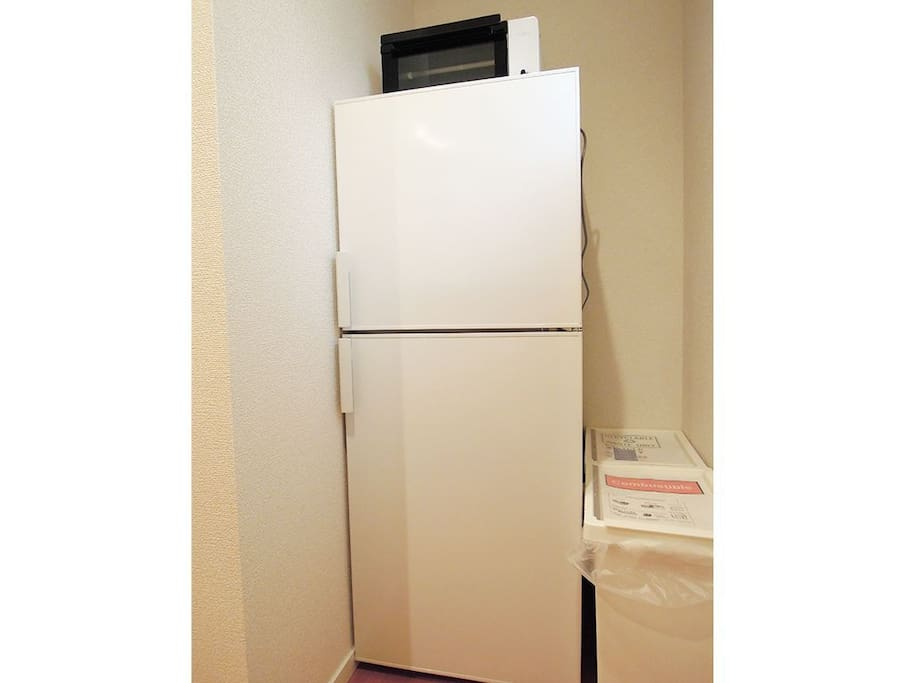 A refrigerator and microwave oven for use of you