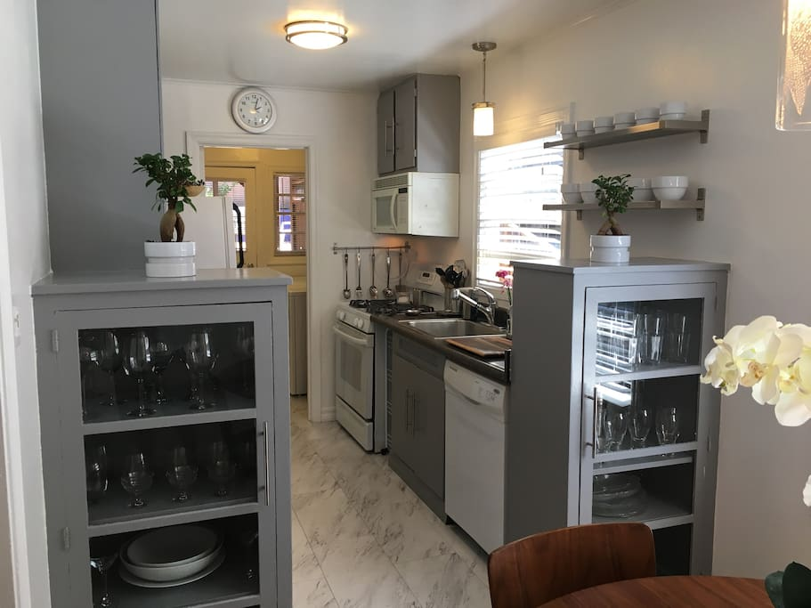 Beautiful galley kitchen with lots of bright sunshine.  A great place to start your day with a fresh cup of coffee.