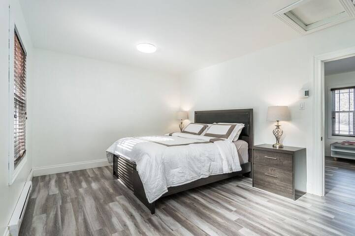 Spacious bedroom with comfortable queen bed.