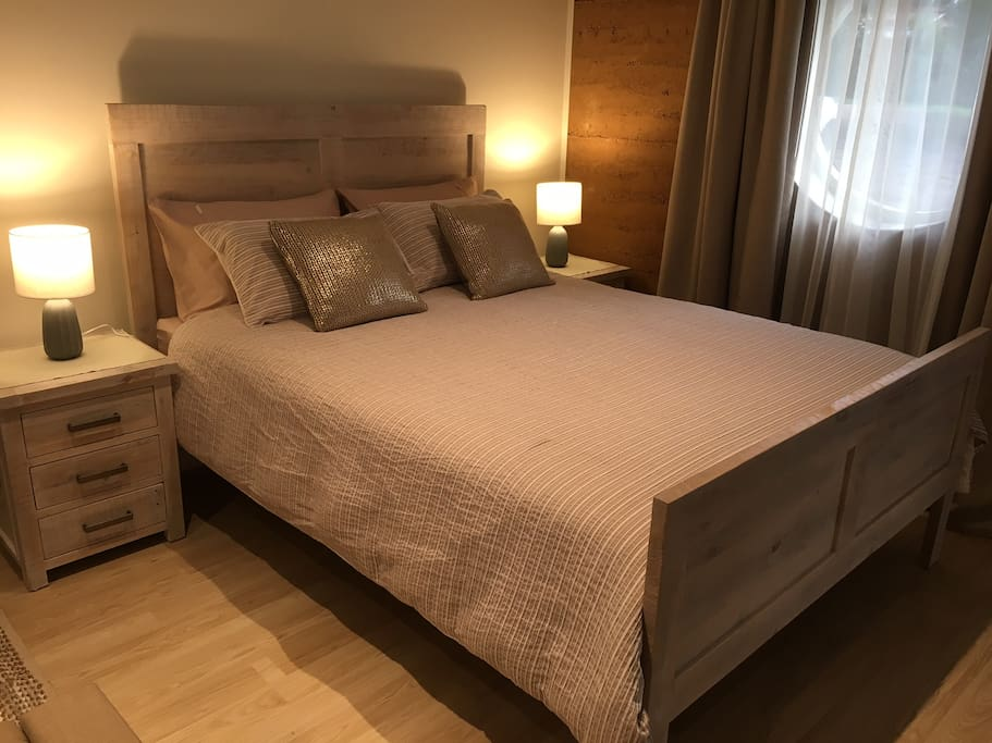 New queen size bed featuring luxury mattress and exclusive Sheridan bedding.