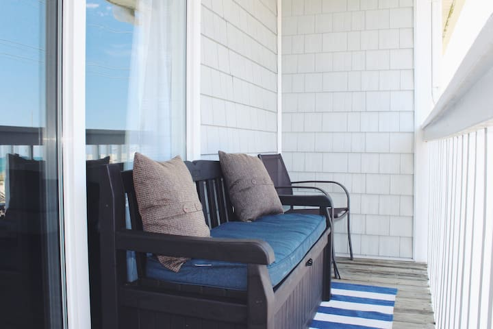 The balcony is a great spot to relax, but if you are heading to the beach, lift up the bench and grab a chair.