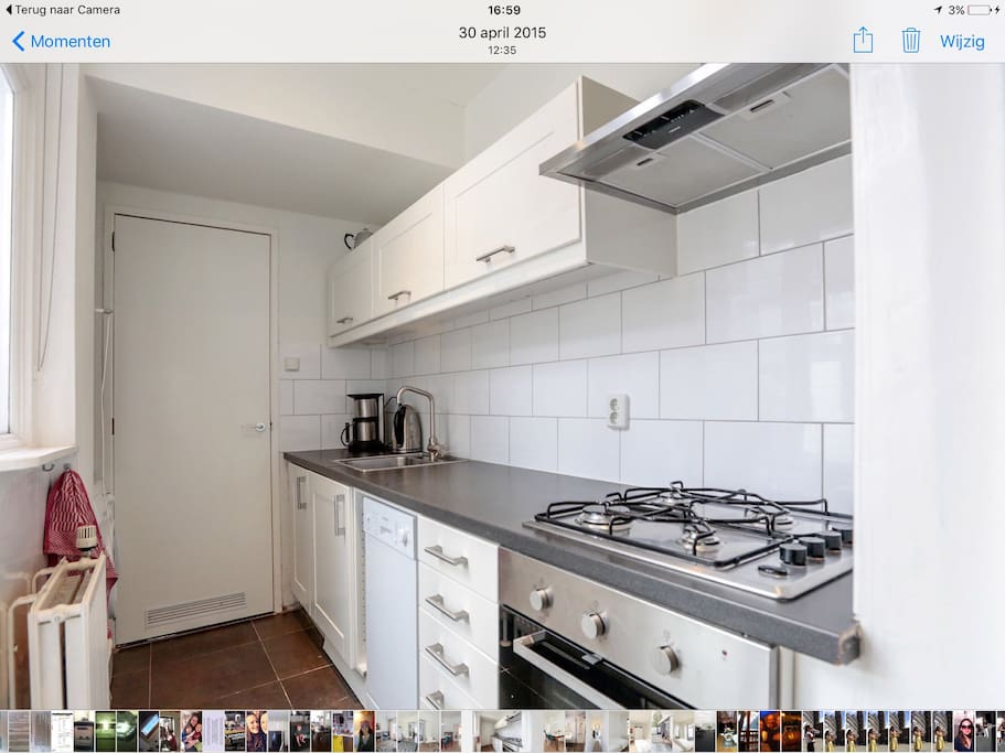 Modern kitchen with oven, microwave, fridge , dishwasher and washing machine