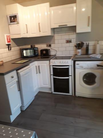 kitchen -microwave, toaster, fridge, freezer, kettle , coffee machine, washing machine.