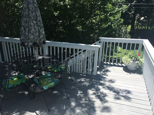 Private deck that overlooks back yard.  Gas grill not shown.