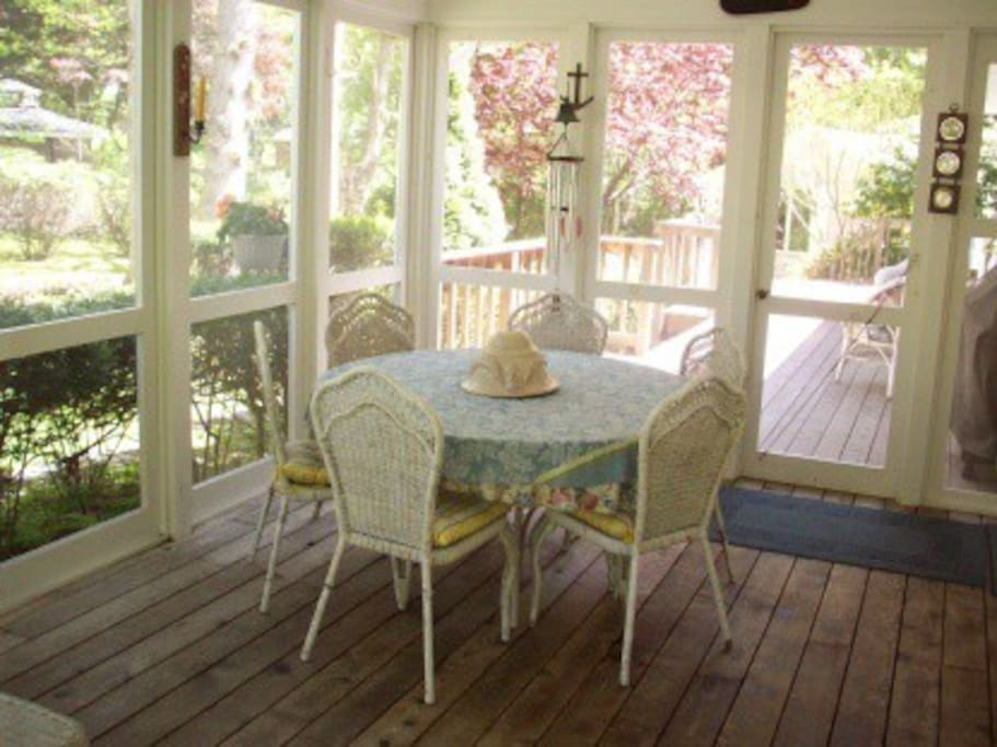 Screened porch next to deck