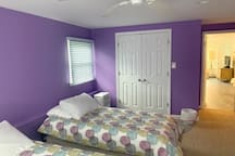 Purple bedroom includes a large closet and 4 twin Tempur-Pedic beds.