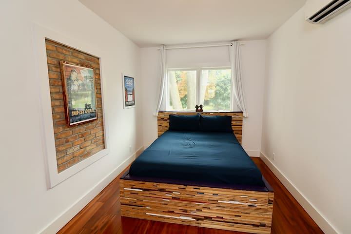 Guest room. (Featuring queen bed I made from construction debris.)