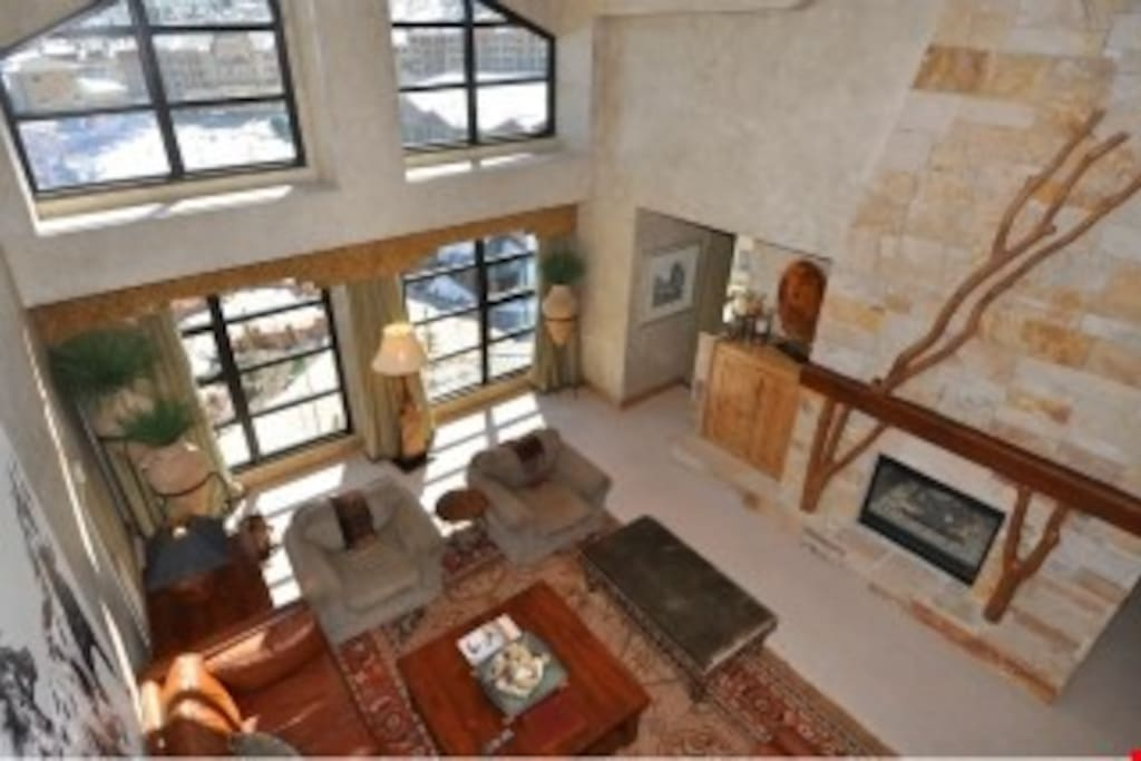 Enjoy vaulted ceilings and beautiful floor to ceiling windows with mountain views