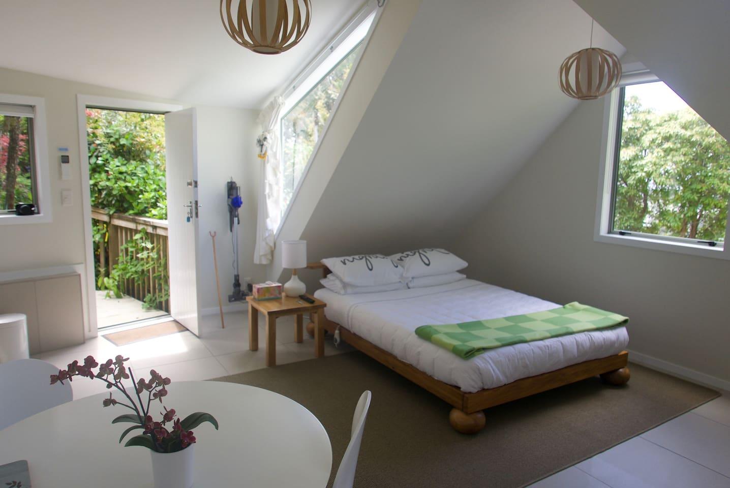 A bright, airy, open-plan studio apartment