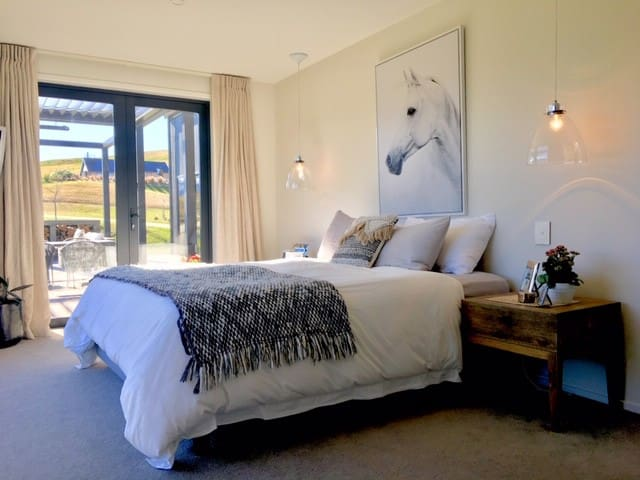 Master Bedroom Main House leads to deck and has view of Coronet Peak