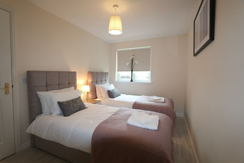 Bedroom 2, configured either as two single beds or securely zipped together for a double.