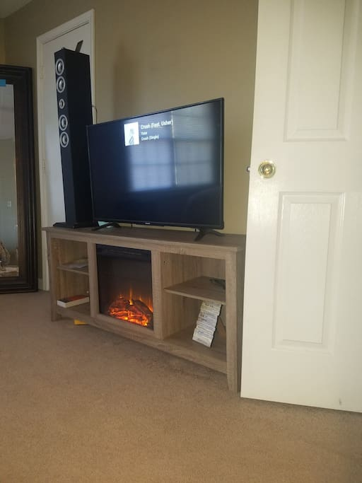 Tv stand with 4k tv and  surround soundtower.