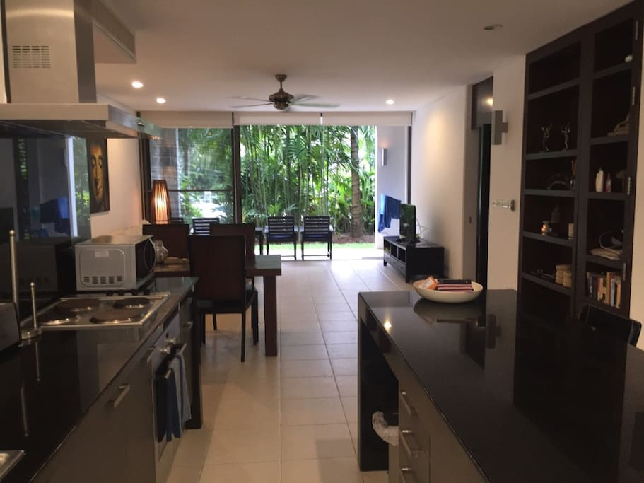 Large Kitchen area with cooking facilities and washing machine