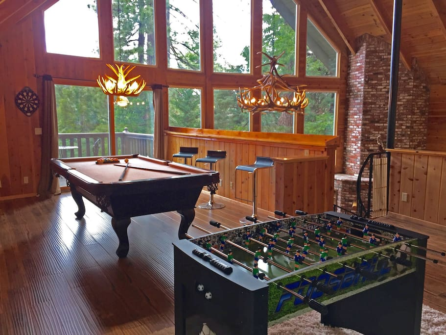 Upper level game room loft with pool table, darts, and foosball.