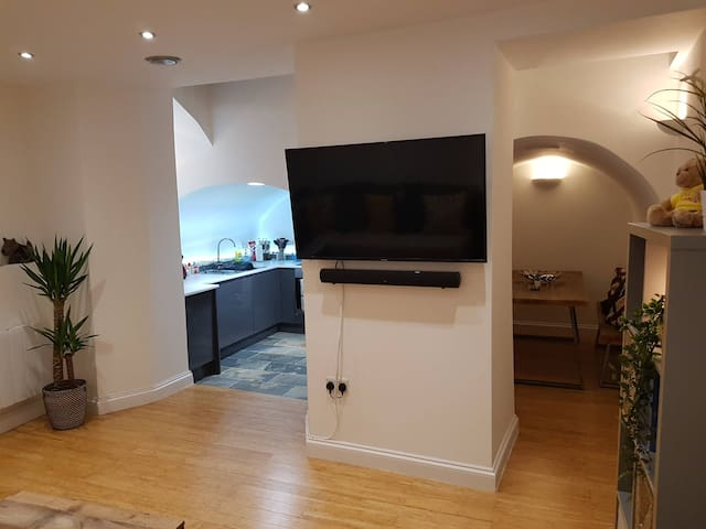 50 inch TV, dining and kitchen
