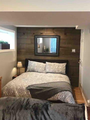Queen bed in beautifully decorated bedroom area