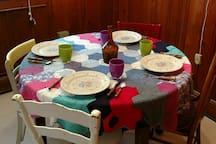 Table folds out to seat at least 6 people.  I crocheted the tablecloth myself.