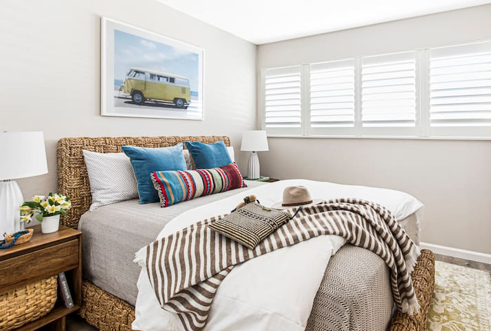 The fourth bedroom is complete with comfortable Queen bed, premium linens and mountain views.