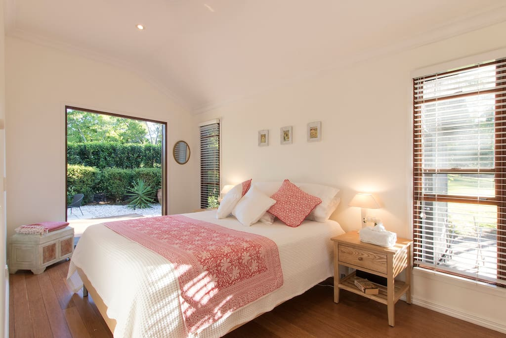 Frangipani room featuring queens sized bed