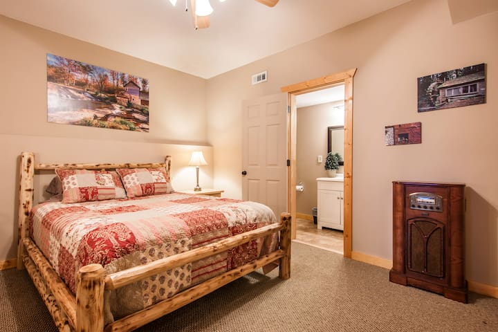 Lower Master Bedroom with ensuite bathroom with shower